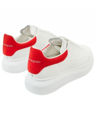 Red and white leather sneakers