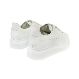White leather sneakers with colorful eyelets